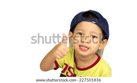 Portrait of happy young boy with blue caps and light green shirt showing thumbs up gesture, isolated over white background - stock photo