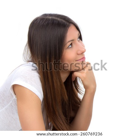 Portrait of happy young brunette woman thinking isolated on a white background - stock photo