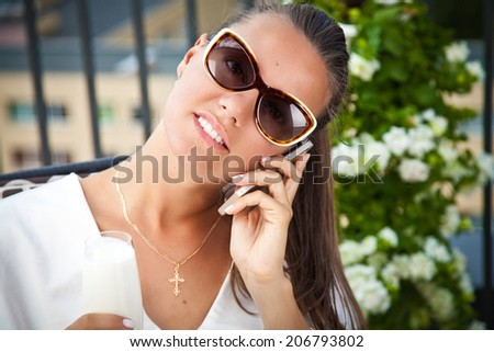 Portrait of happy young business woman Talking On Mobile Phone. Technology entertainment.