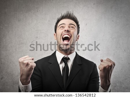 portrait of happy young businessman - stock photo