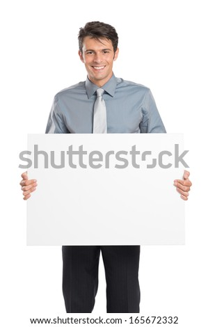 Portrait Of Happy Young Businessman Holding Blank Placard Isolated On White Background