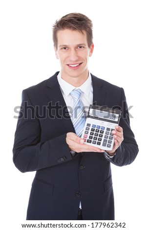 Portrait Of Happy Young Businessman Showing Calculator Over White Background