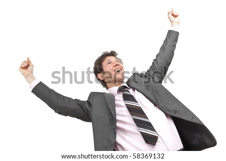 Portrait of happy young businessman standing in winning pose with hands raised, smiling.  Isolated on white. - stock photo