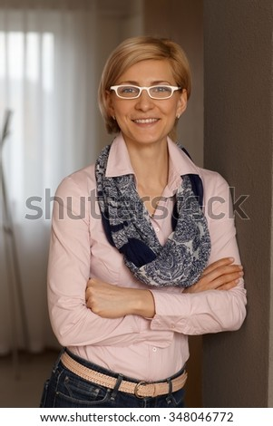 Portrait of happy young businesswoman, smiling, looking at camera.