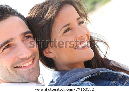 Portrait of happy young couple - stock photo