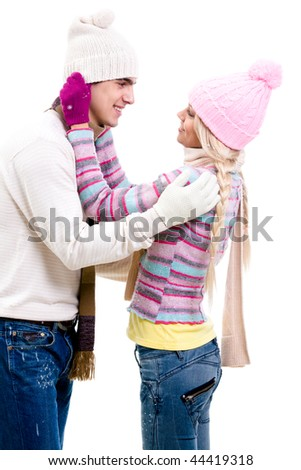 Portrait of happy young couple in warm clothes looking at each other