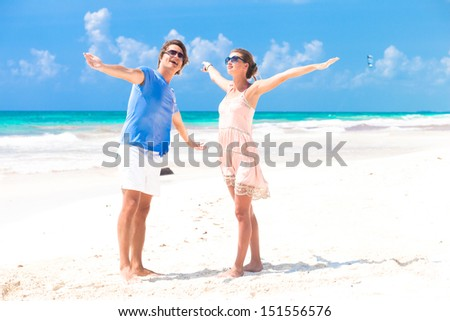 portrait of happy young couple walking on the beach. Tulum, Mexico, Honeymoon concept