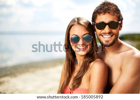 Portrait of happy young dates on the beach - stock photo