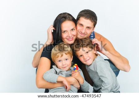 Portrait of happy young family with two sons