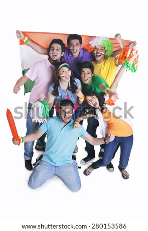 Portrait of happy young friends cheering with Indian flag over white background - stock photo