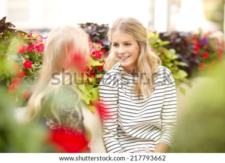 Portrait of happy young friends reunion, while sitting at cafe outside.  - stock photo