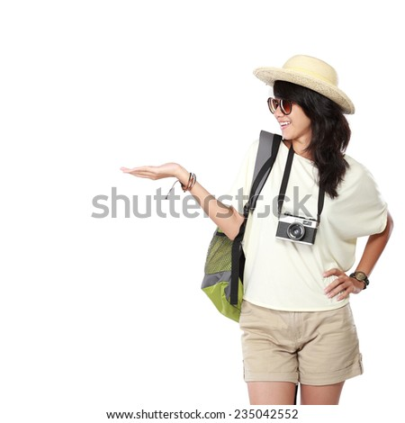 portrait of happy young girl backpack pointing blank space - stock photo