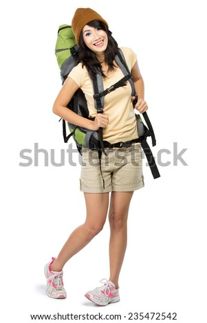 portrait of happy young girl bring backpack and smile