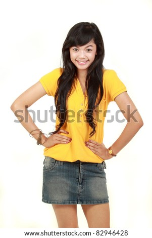 Portrait of happy young girl isolated on white background - stock photo