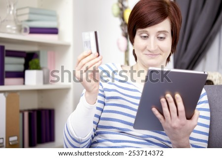 Portrait happy young girl tablet computer stock photo 253714372 portrait of happy young girl with tablet computer shopping for easter gifts at home negle Images