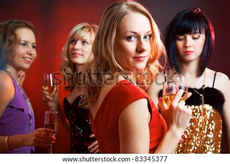 Portrait of happy young girls  on the party - stock photo