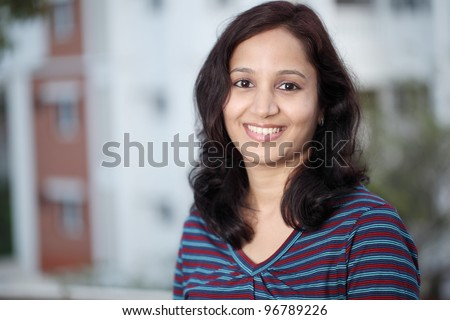 Portrait of happy young Indian woman - stock photo