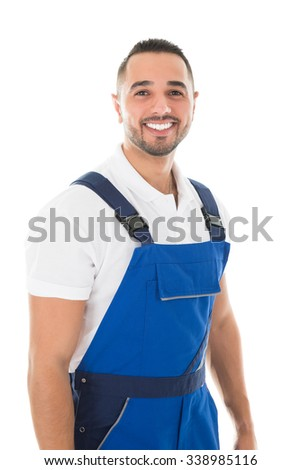 Portrait of happy young janitor standing against white background - stock photo