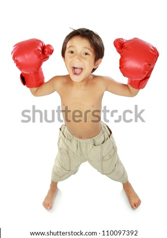 portrait of happy young kid with boxing glove in winning pose - stock photo