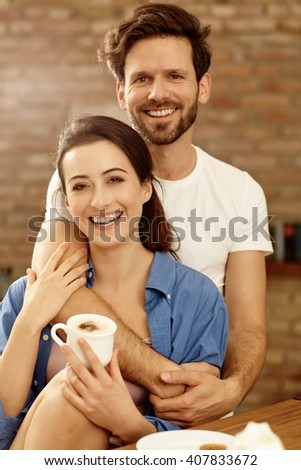 Portrait of happy young loving couple hugging in the morning. - stock photo