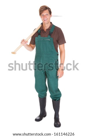 Portrait Of Happy Young Male Gardener With Shovel On White Background - stock photo