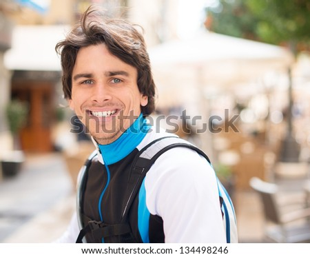 Portrait Of Happy Young Man Cyclist; Outdoors - stock photo