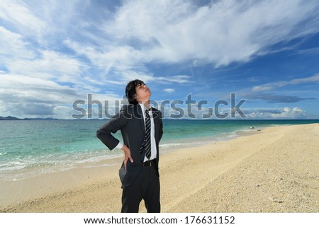 Portrait of happy young man on a tropical beach