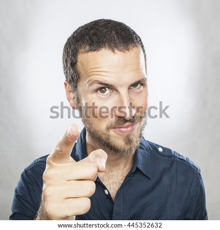 Portrait of happy young man pointing at you