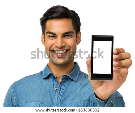 Portrait of happy young man showing smart phone over white background. Horizontal shot. - stock photo