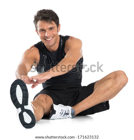 Portrait Of Happy Young Man Stretching Isolated On White Background