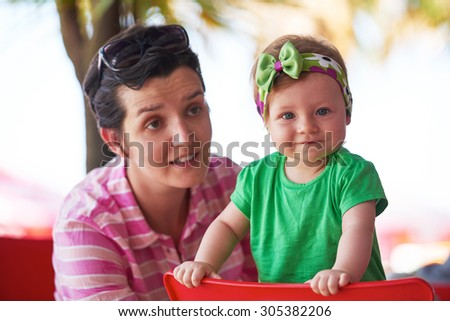 portrait of happy young mother and baby  while have  fun