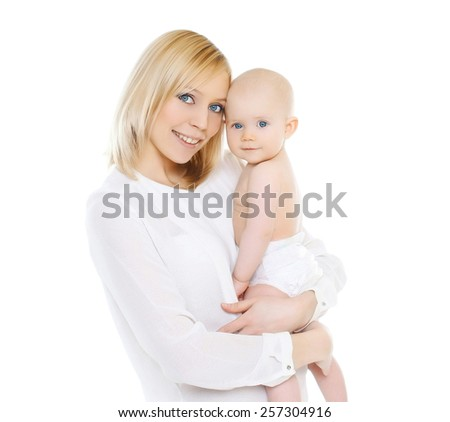 Portrait of happy young mother and her baby together - stock photo