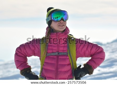 Portrait of happy young skier - stock photo