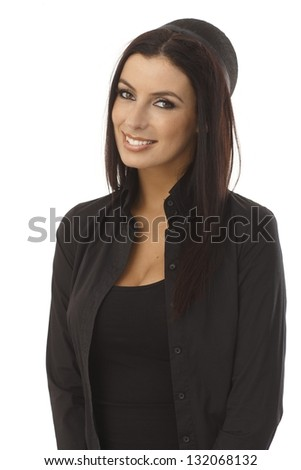 Portrait of happy young stewardess smiling.