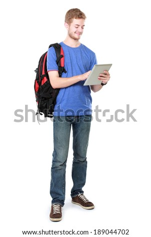 portrait of happy young student using tablet pc isolated on white background - stock photo