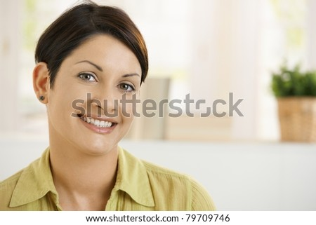 Portrait of happy young woman at home, smiling.? - stock photo