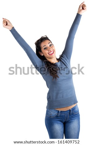 portrait of happy young woman celebrating something - stock photo