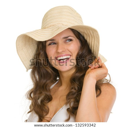 Portrait of happy young woman in hat