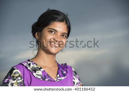 Portrait of happy young woman smiling, looking at camera. - stock photo