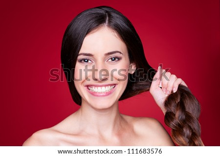 portrait of happy young woman with strong hair - stock photo