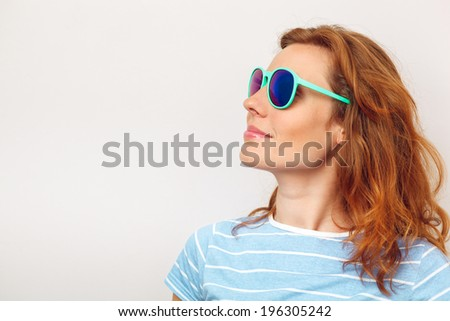 Portrait of happy Young woman with sunglasses.