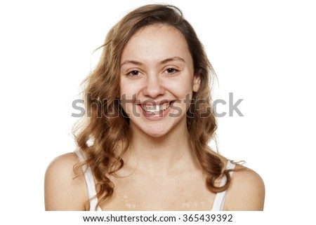 portrait of happy young woman without make-up - stock photo