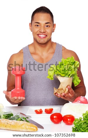 Portrait of healthy man posing in studio with food