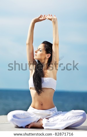 Portrait of healthy young woman doing yoga - stock photo