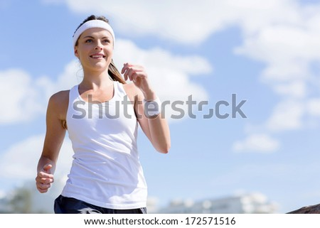 portrait of healthy young woman jogging  - stock photo
