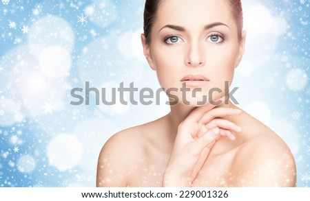 Portrait of healthy young woman over winter background - stock photo
