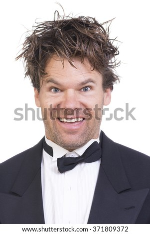 Portrait of high Caucasian man with crazy facial expression and messy long hair on white background - stock photo