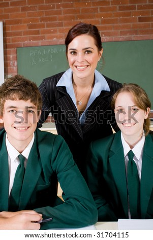 portrait of high school teacher and students - stock photo