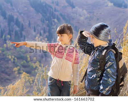 Portrait of hiking caucasian boy and girl - stock photo