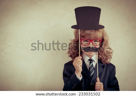 Portrait of hipster businessman in modern loft office. Success, creative and innovation concept. Copy space for your text - stock photo